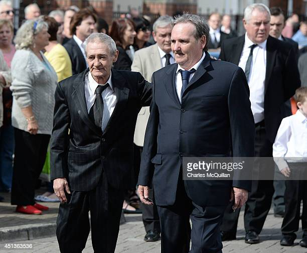 The coffin of Gerry Conlon is carried into St Peter's Cathedral for a requiem mass watched by fellow Guildford Four members Paddy Armstrong and Paddy...