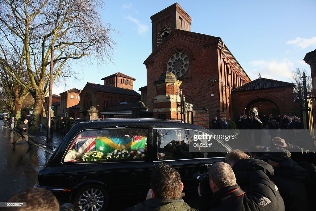 The coffin of 'Great Train Robber' Ronnie Biggs arrives at Golders Green Crematorium during his funeral on January 3 2014 in London England Biggs who...