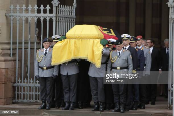 The coffin of Helmut Kohl covered in a German flag is carried out of the Speyer Cathedral by eight soldiers A funeral mass for the former German...