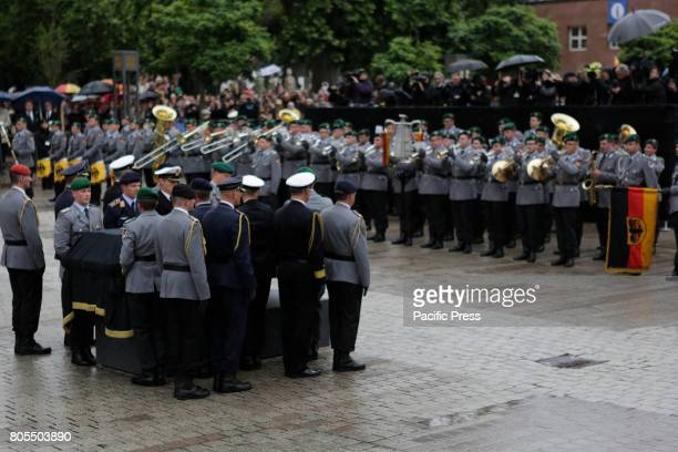 The coffin of Helmut Kohl is placed on a catafalque opposite a military honour guard A funeral mass for the former German Chancellor Helmut Kohl was...
