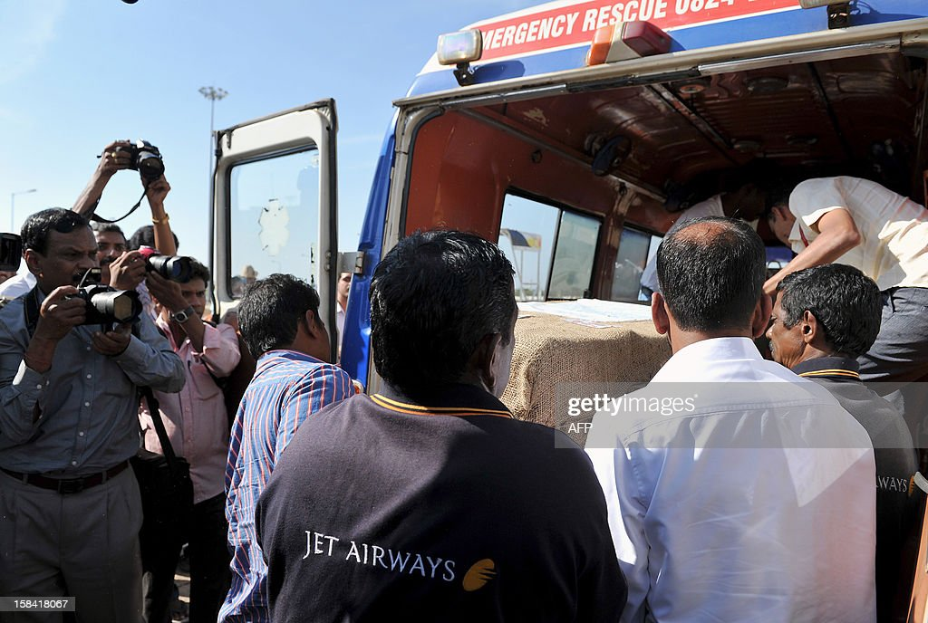 The coffin of India-born nurse Jacintha Saldanha, 46, is loaded onto an ambulance after she was brought out of the Bajpe Airport in Mangalore on December 16, 2012. The body of Saldanha who was found hanged after taking a hoax call to the hospital treating Prince William's wife arrived in Mangalore following a memorial mass in London. AFP PHOTO/ Manjunath KIRAN