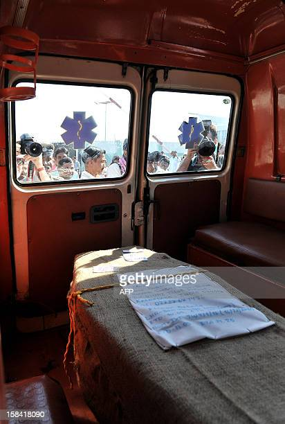 The coffin of Indiaborn nurse Jacintha Saldanha is loaded onto an ambulance after she was brought out of the Bajpe Airport in Mangalore on December...