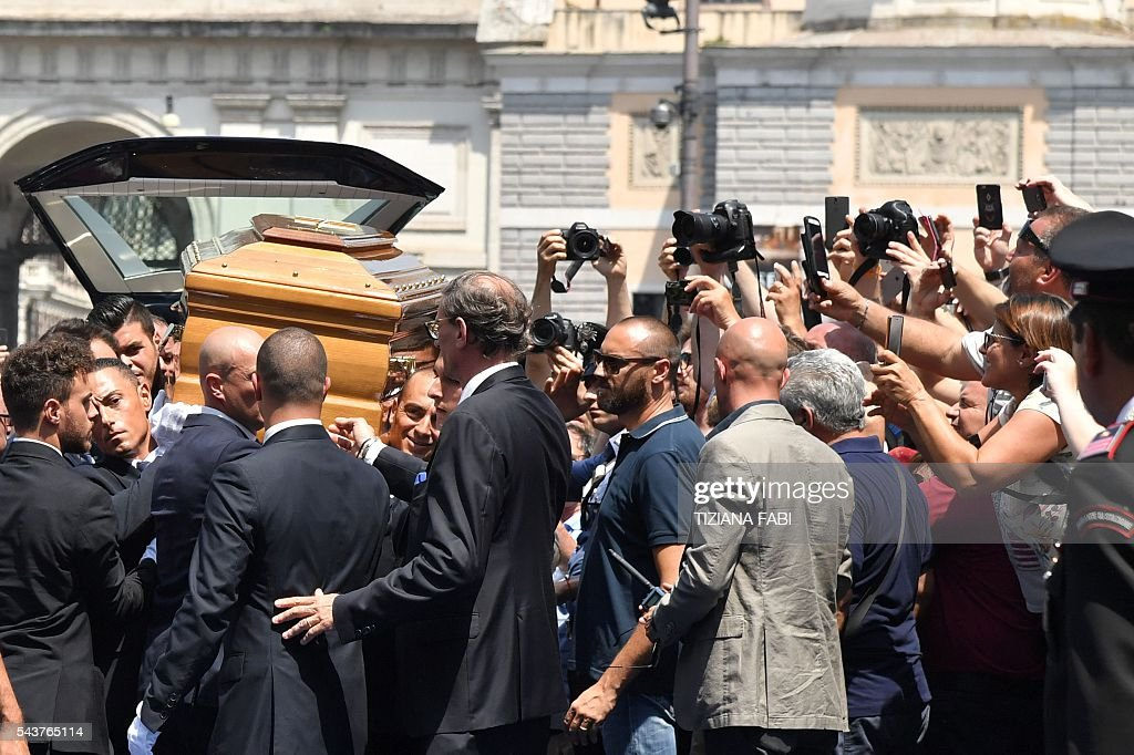 The coffin of Italian actor Bud Spencer, born Carlo Pedersoli, is carried outside the church of the artists, Santa Maria in Montesanto, on June 30, 2016 before the funeral at Piazza del Popolo in Rome. Bud Spencer who starred in a string of spaghetti westerns, died on June 27 in Rome aged 86. Spencer, born in Italy in 1929, played in 16 films alongside Terence Hill, whose real name was Mario Girotti. / AFP / TIZIANA