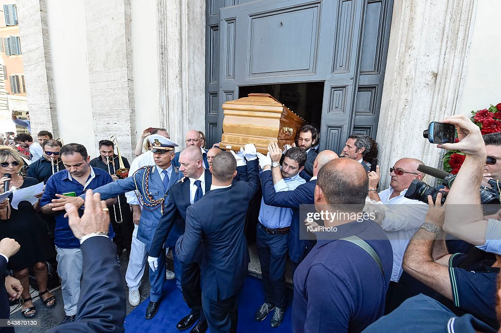 The coffin of Italian actor <a gi-track='captionPersonalityLinkClicked' href=/galleries/search?phrase=Bud+Spencer&family=editorial&specificpeople=707220 ng-click='$event.stopPropagation()'>Bud Spencer</a>, born Carlo Pedersoli, is carried outside the 'church of the artists', Santa Maria in Montesanto, on June 30, 2016 at Piazza del Popolo in Rome