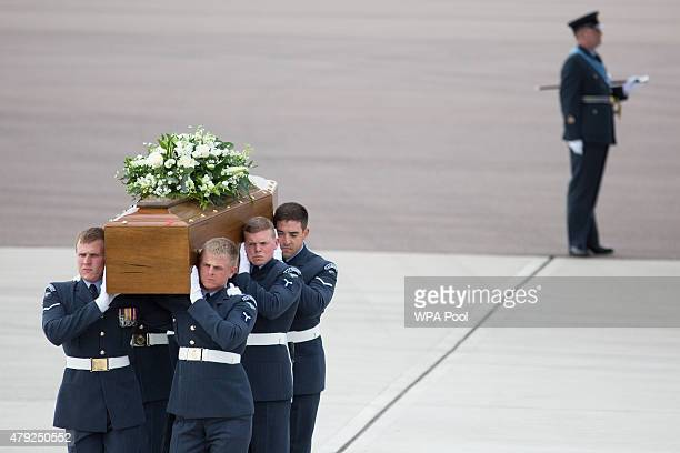 The coffin of John Stocker is taken from the RAF C17 aircraft after it landed at RAF Brize Norton carrying nine of the victims of last Friday's...