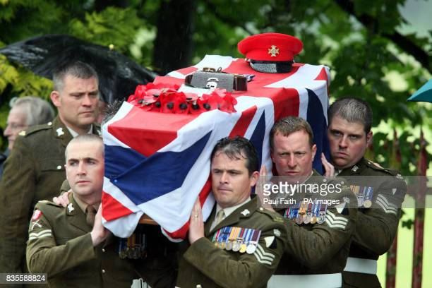 The coffin of Lance Corporal Nigel Moffett of the Light Dragoons Regiment is carried for burial at Redburn cemetery in Holywood Co Down