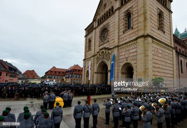 The coffin of late former Chancellor Helmut Kohl leaves the cathedral with military honors on July 1 2017 after a memorial service in Speyer Helmut...