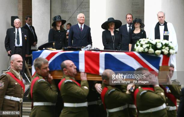 The coffin of Lieutenant Colonel Rupert Thorneloe is carried into the Guard's Chapel in central London as his wife Sally Thorneloe father Major John...