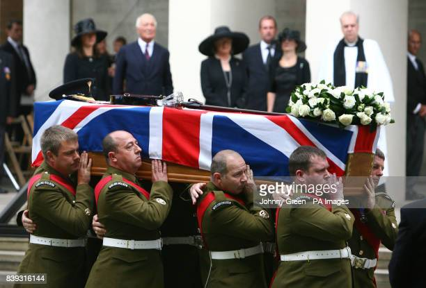 The coffin of Lieutenant Colonel Rupert Thorneloe is carried into the Guard's Chapel in central London as wife Sally Thorneloe father Major John...