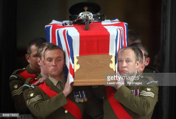 The coffin of Major Sean Birchall of the 1st Battalion Welsh Guards is carried from the Guards Chapel London following his funeral service