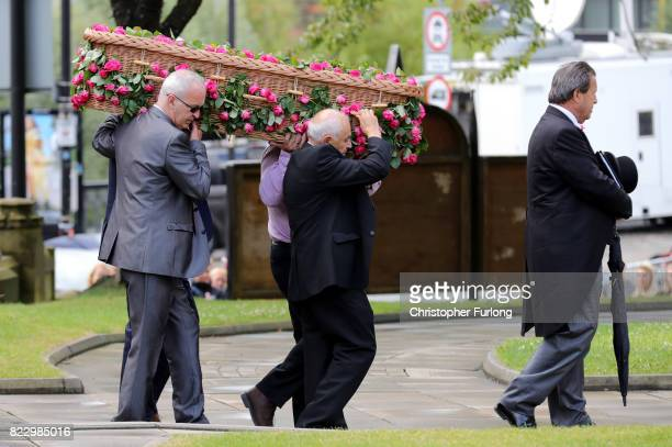 The coffin of Manchester Attack victim Saffie Roussos is carried as it arrives for her funeral at Manchester Cathedral on July 26 2017 in Manchester...