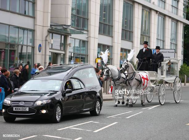 The coffin of Martyn Hett arrives at Stockport Town Hall for his funeral service in a white horse drawn carriage on June 30 2017 in Stockport England...