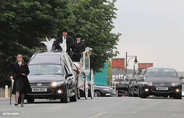 The coffin of Martyn Hett who was killed in the Manchester Arena bombing arrives at Stockport Town Hall Plaza for his funeral service