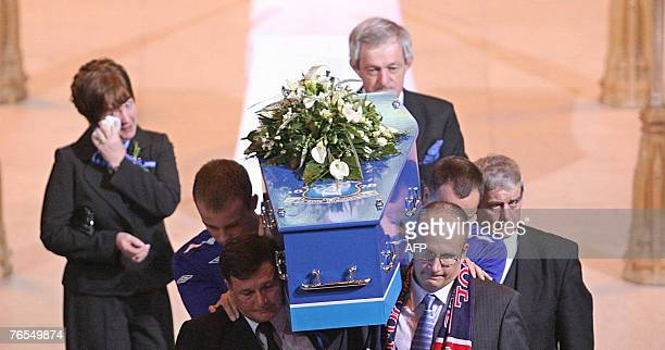 The coffin of murdered 11yearold schoolboy Rhys Jones is carried out of the Liverpool Anglican Cathedral in Liverpool northwest England 06 September...