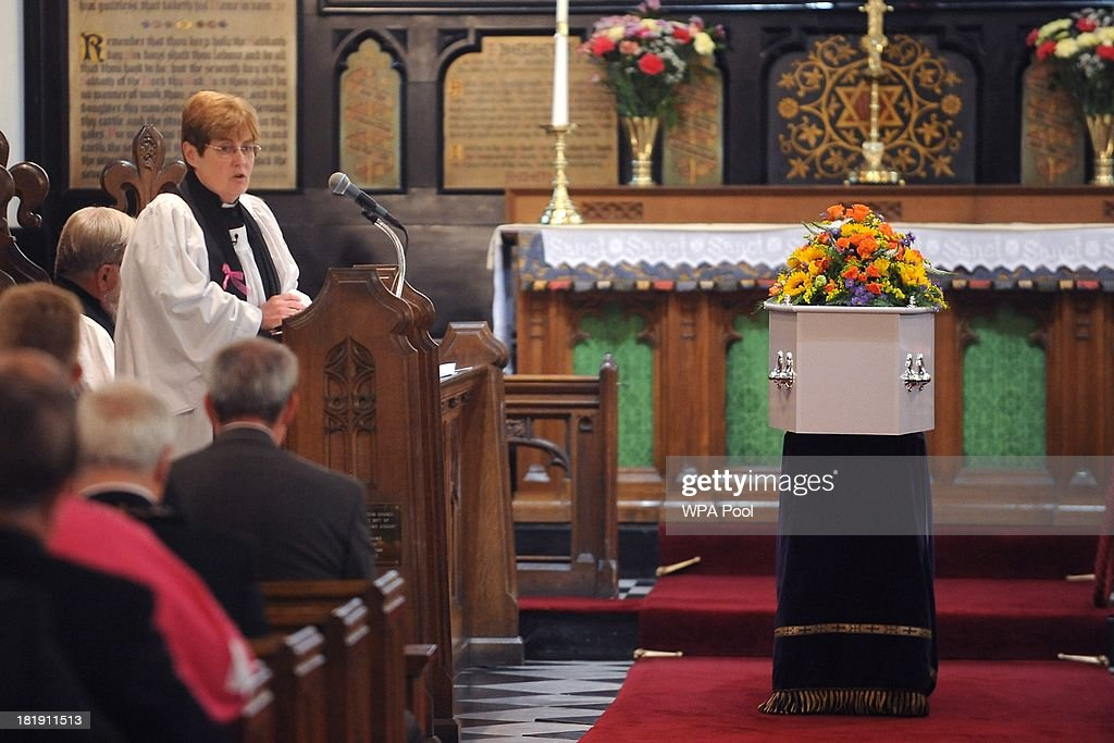 The coffin of murdered schoolgirl April Jones rests inside St Peter's Church as The Reverend Kathleen Rogers leads her funeral service on September 26, 2013 in Machynlleth, Wales. Local man Mark Bridger, aged 47, was found guilty of abducting and murdering five-year-old April who went missing in Machynleth on October 1, 2012.
