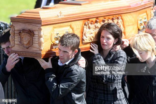 The coffin of Patrick 'PJ' McLaughlin is carried from his funeral service at St Mary's Church in Fahan Co Donegal Mr McLaughlin was one of eight men...