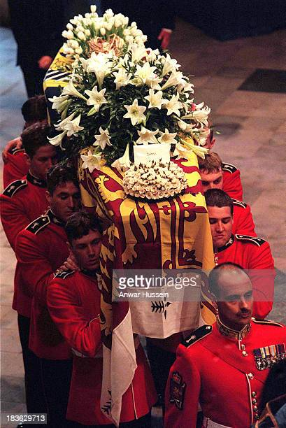 The coffin of Princess Diana Princess of Wales leaves Westminster Abbey after the funeral service on September 6 1997 The touching floral tribute...