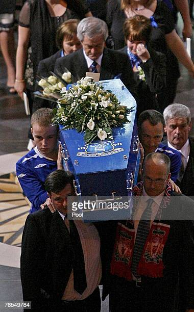 The coffin of Rhys Jones is carried out of Liverpool's Anglican Cathedral followed by mother Melanie Jones after the funeral service for the murdered...