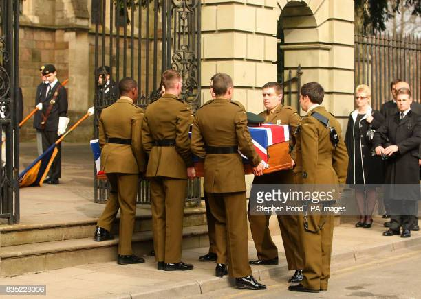 The coffin of Rifleman Jamie Gunn arrives at St Mary's Church in Monmouth for the funeral service Rifleman Jamie Gunn was with Corporal Tom Gaden and...