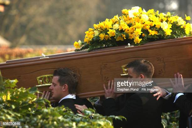 The coffin of Rifleman Jamie Gunn who was killed in Helmand province Afghanistan on February 25 is carried by his rugby friends after his funeral...