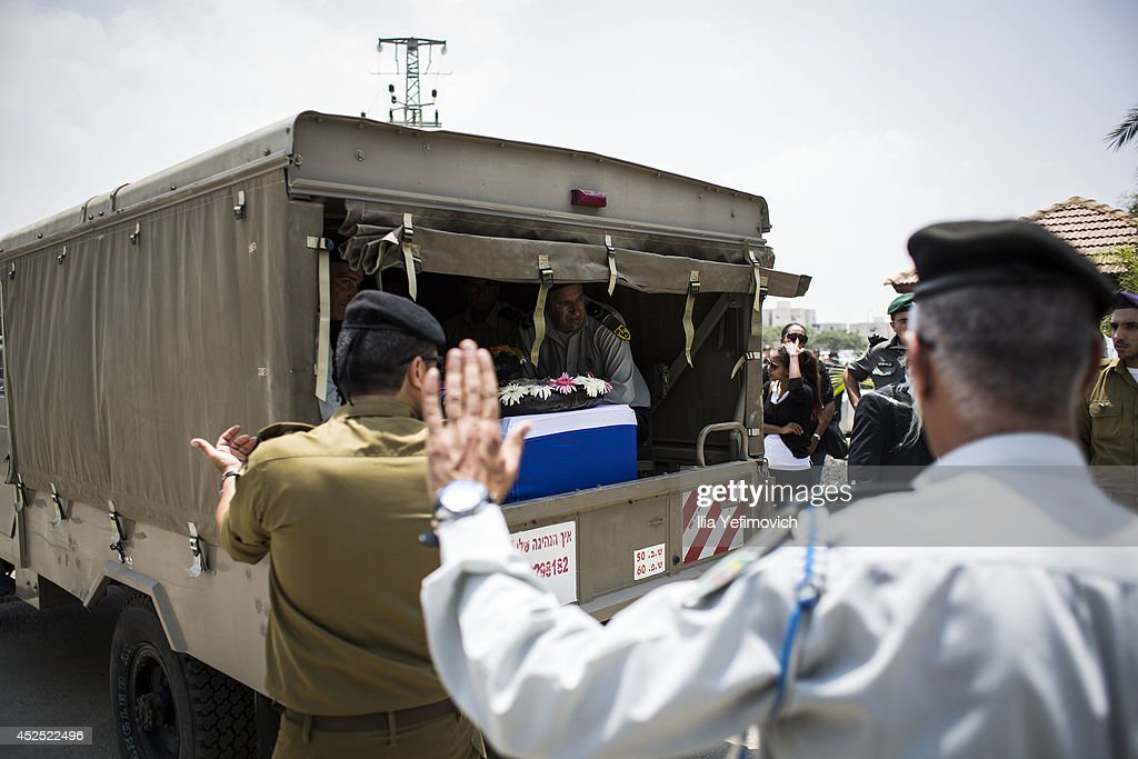 The coffin of Sergeant Major Bayhesain Kshaun seen arriving to his funeral on July 22 2014 in Netivot Israel As operation 'Protective Edge' goes into...