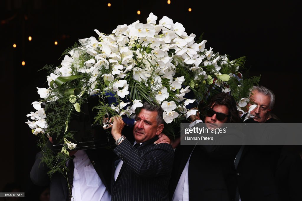 The coffin of Sir Paul Holmes is carried out at Auckland Cathedral of the Holy Trinity in Parnell on February 8, 2013 in Auckland, New Zealand. Hundreds gathered to pay their respects to Sir Paul Homes who passed away last Friday after losing his battle with prostate cancer. Holmes broadcasting career spanned over 40 years on radio and television in New Zealand, Australia, Netherlands and the UK.