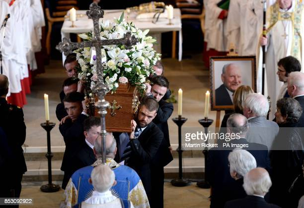 The coffin of Sir Tom Finney is carried from St John's Minster after his Funeral service Preston