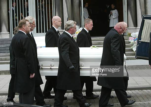 The coffin of slain Dutch politician Pim Fortuyn is carried outside the cathedral after his funeral service in Rotterdam Netherlands May 10 as...