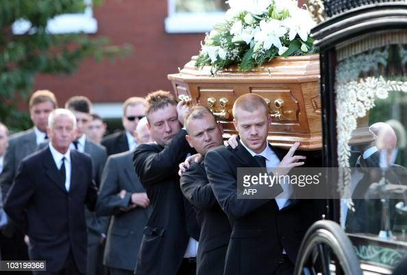 The Coffin of Snooker player Alex Higgins is carried by his son Jordon Higgins and former Snooker Champion Jimmy White from his family home in...