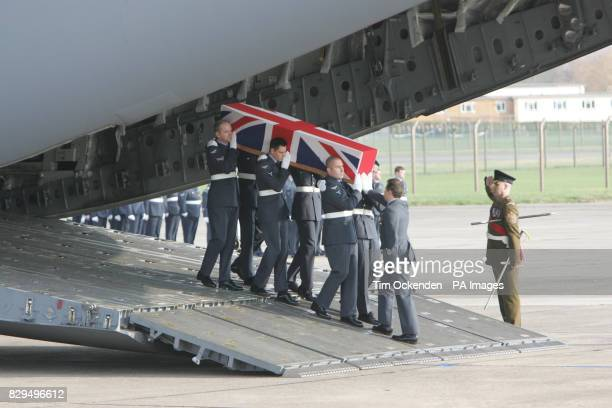 The coffin of Squadron Leader Patrick Marshall who was one of ten servicemen killed when the C130 Hercules plane they were travelling in crashed in...