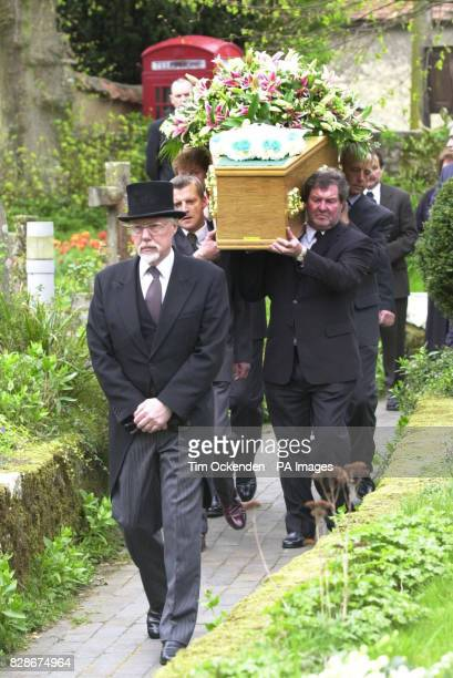 The coffin of television reporter Terry Lloyd who died while covering the war in Iraq is carried into St Nicholas Church Cuddington Buckinghamshire...