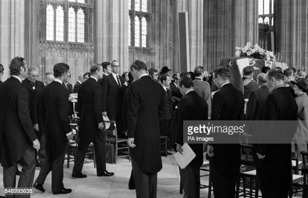 The coffin of the Duke of Windsor carried by a bearer party of Prince of Wales Company first Battalion Welsh Guards in procession in St George's...