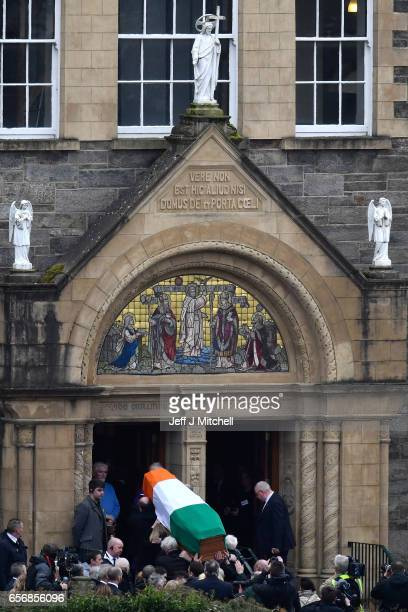 The coffin of the late Martin McGuinness arrives at St Columba's Church on March 23 2017 in Londonderry Northern Ireland The funeral is held for...