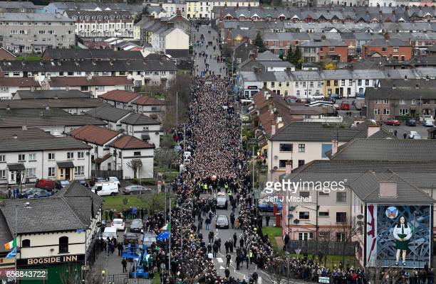The coffin of the late Martin McGuinness is carried as the funeral cortege passes through the streets of Derry on March 23 2017 in Londonderry...