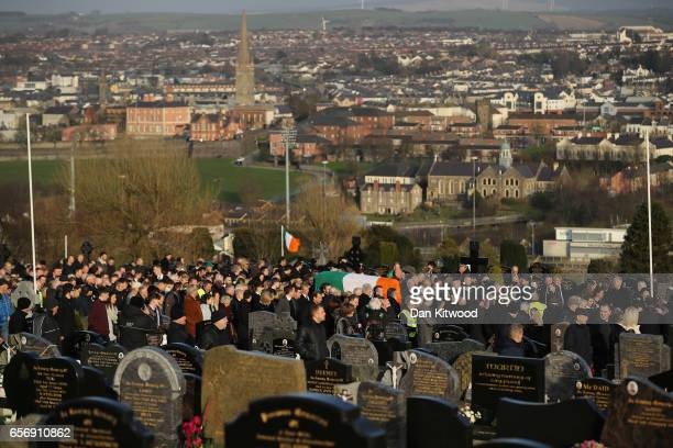 The coffin of the late Martin McGuinness is carried into the Derry City Cemetery on March 23 2017 in Londonderry Northern Ireland The funeral is held...