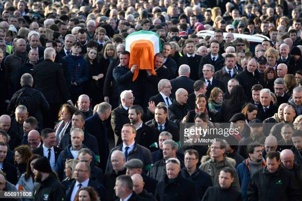 The coffin of the late Martin McGuinness is carried to Derry City Cemetery on March 23 2017 in Londonderry Northern Ireland The funeral is held for...