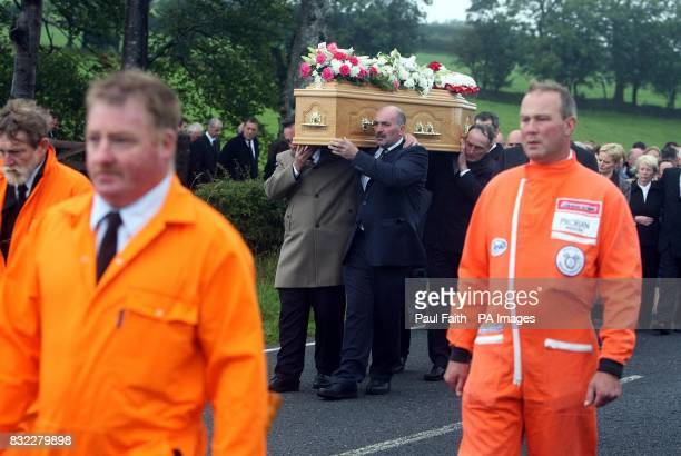 The coffin of top Irish Motorcycle road racer Darran Lindsay is carried from his County Antrim home
