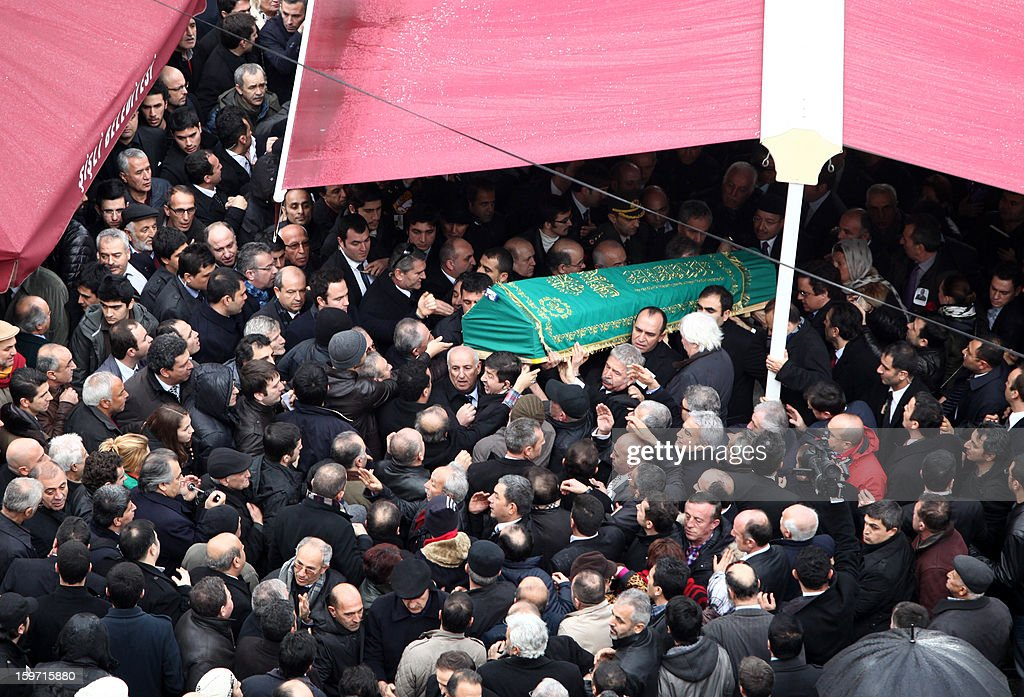 The coffin of Turkish journalist Mehmet Ali Birand. who died on January 17, 2013 after gall bladder surgery, is carried by colleagues on January 19, 2013 outside the Tesvikiye mosque in Istanbul. A liberal journalist and political commentator, Birand was the anchorman of Turkish broadcaster Kanal D's main news bulletin, wrote daily columns and moderated a hard-talk program. AFP PHOTO / STR