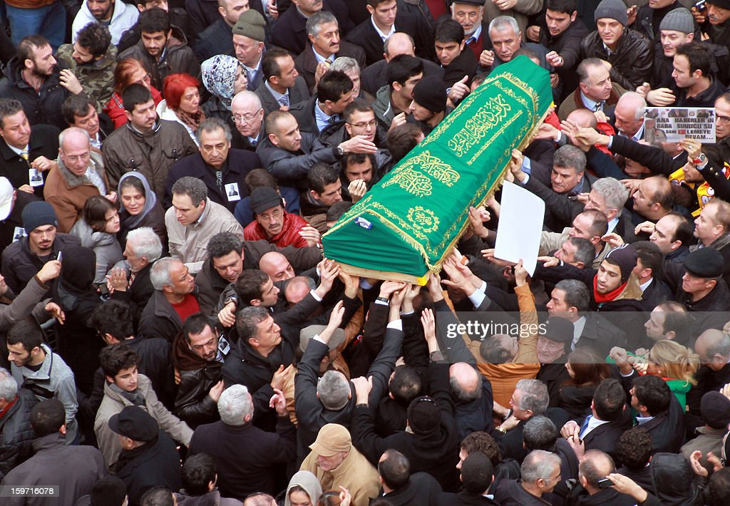 The coffin of Turkish journalist Mehmet Ali Birand. who died on January 17, 2013 after gall bladder surgery, is carried by colleagues on January 19, 2013 outside the Tesvikiye mosque in Istanbul. A liberal journalist and political commentator, Birand was the anchorman of Turkish broadcaster Kanal D's main news bulletin, wrote daily columns and moderated a hard-talk program.