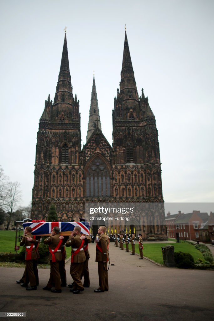 The coffin of Warrant Officer Ian Fisher from The 3rd Battalion The Mercian Regiment arrives at Lichfield Cathedral for his funeral service on...