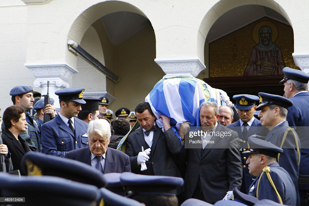 The coffin, wrapped in a Greek flag, is carried out of the church of St. Anthony. The funeral of the first of the two Hellenic Air Force pilots who died at an accident during a NATO exercise in Spain's Los Llanon airbase,  which killed 11 people, Flight Lieutenant Panagiotis Lascaris, was held in Athens.