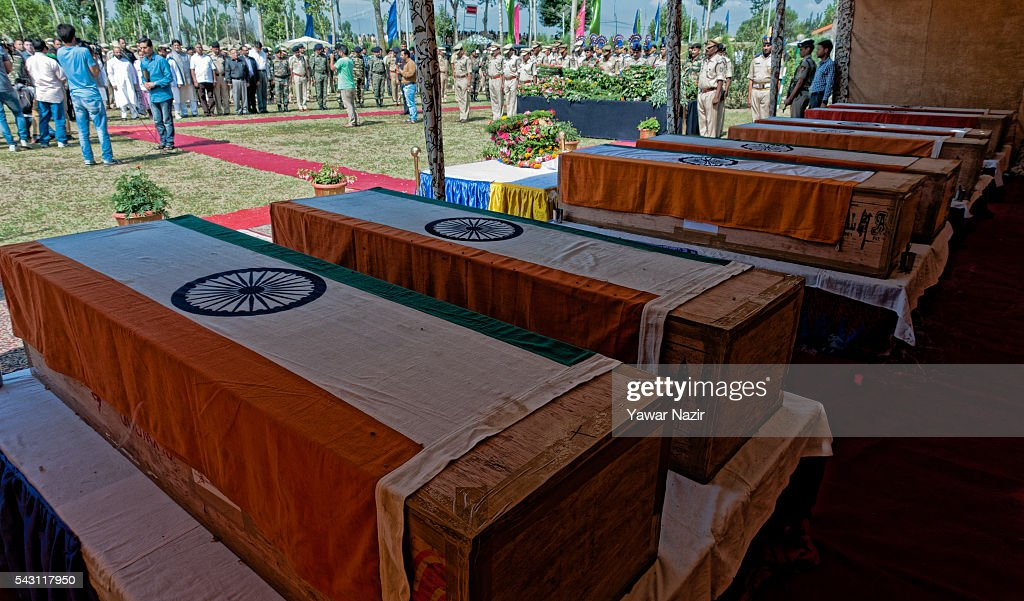 The coffins containing bodies of Indian Paramilitary soldiers of Central Reserve Police Force (CRPF) lie on formation during a wreath-laying ceremony of eight CRPF soldiers killed in an ambush on June 26, 2016 in Srinagar, the summer capital of Indian Administered Kashmir, Indian. Eight Indian Central Reserve Police Force troopers were killed and another twenty critically wounded on Saturday after pro freedom rebels ambushed a paramilitary convoy on the Srinagar-Jammu highway near Pampore in Jammu and Kashmir's Pulwom district, police said. The firing was returned and two rebels were killed in the retaliatory action by the CRPF troopers. A wreath-laying ceremony was held today by the CRPF for their killed comrades.