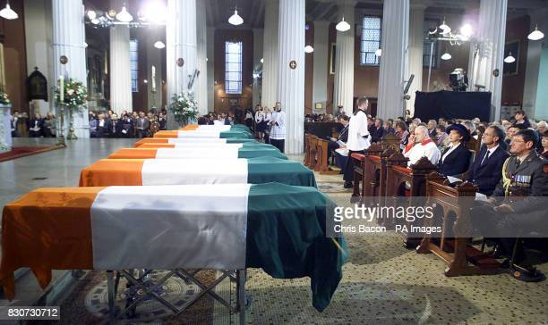 The coffins of 10 War of Independence Volunteers are carried into the Pro Cathedral Dublin for a Requiem Mass Thousands of people lined the streets...
