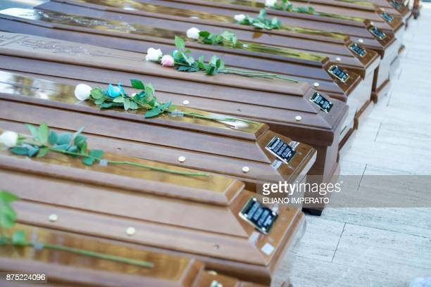 TOPSHOT The coffins of 26 teenage migrant girls found dead in the Mediterranean in early November are pictured in the cemetery of Salerno southern...