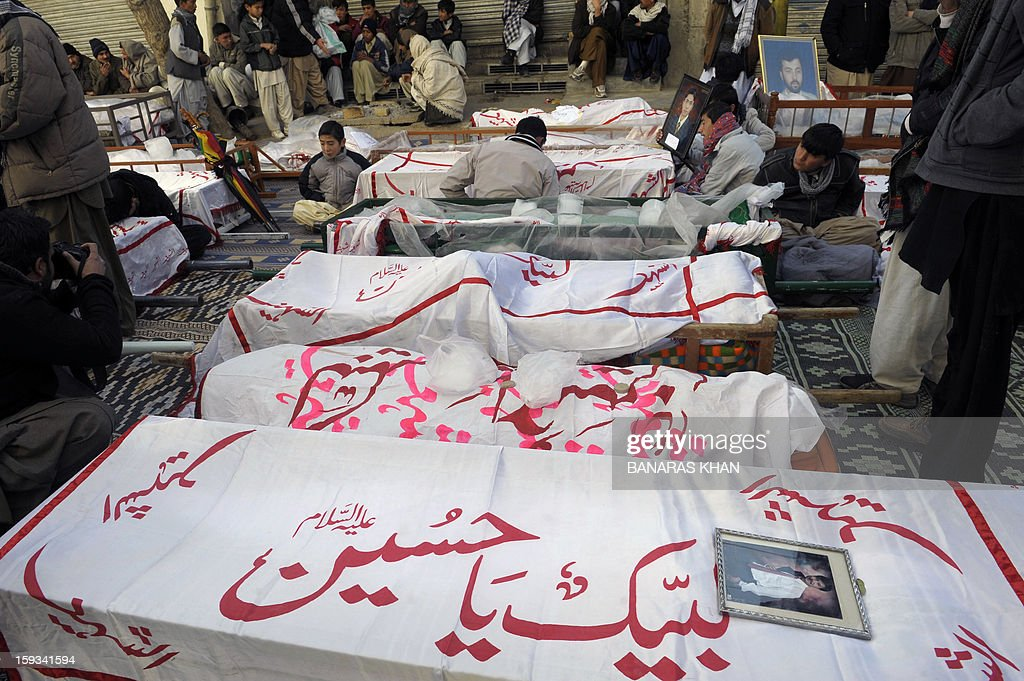 The coffins of bombing victims are seen during a demonstration by Pakistani Shiite Muslims in Quetta on January 12, 2013. Shiite families refusing to bury their dead after twin bombings in Pakistan's troubled southwestern city of Quetta vowed to continue their sit-in protest January 12 until the army takes over security. AFP PHOTO/Banaras KHAN