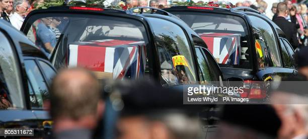 The coffins of Lance Corporal Richard Brandon of the Corps of Royal Electrical and Mechanical Engineers and Private Gavin Elliot of the 2nd Battalion...