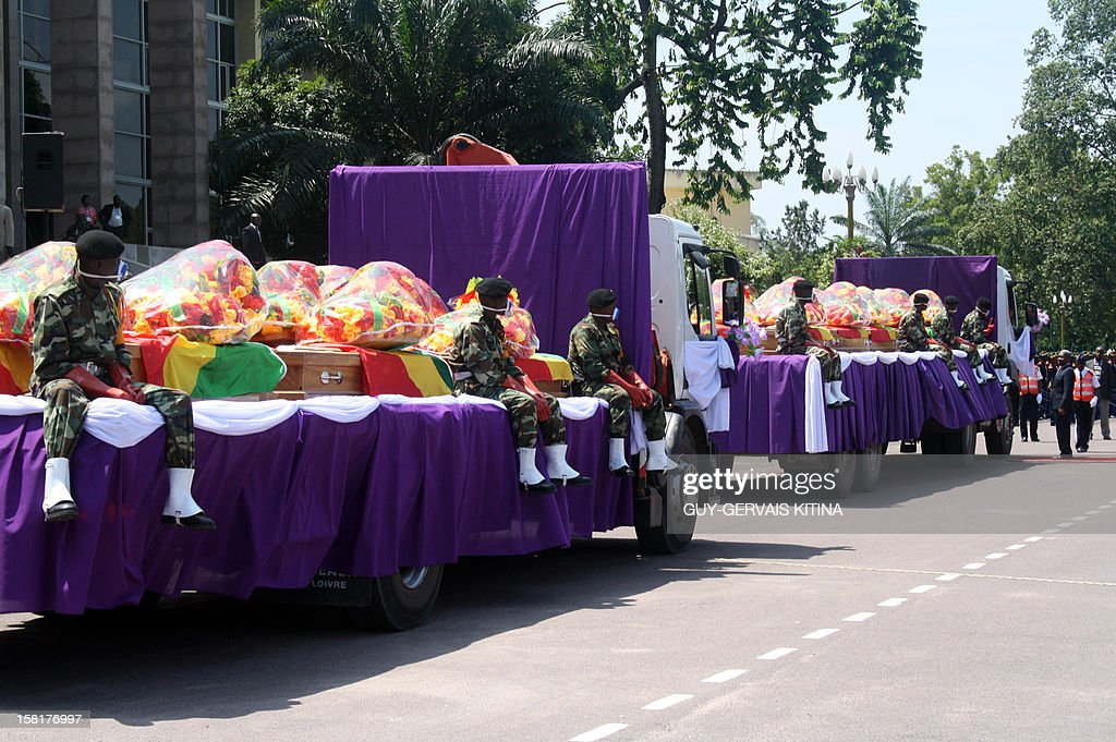 The coffins of the victims killed on November 30 in the crash of a cargo plane arrive on December 10, 2012 in front of the Palais des Congres in Brazzaville for a funeral ceremony. 32 people were killed in the crash of the Ilyushin plane, registered with local company Aero-services, which was flying in from the western port city of Pointe Noire carrying cars and other goods. AFP PHOTO / Guy-gervais Kitina