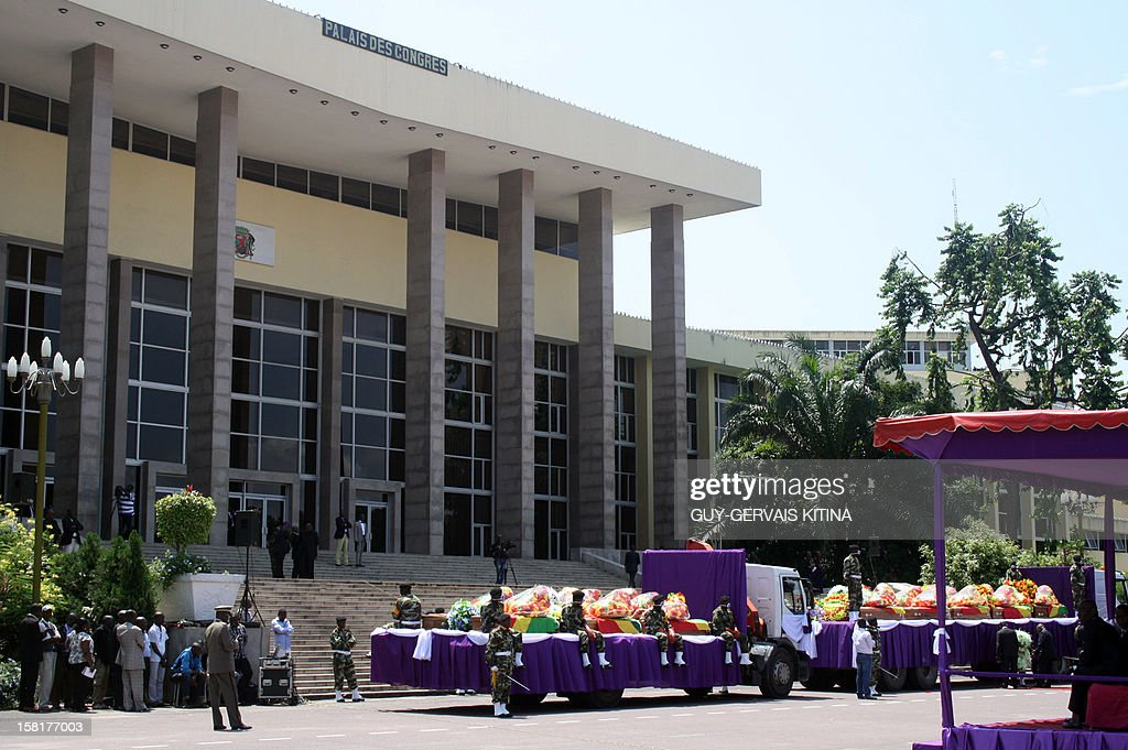The coffins of the victims killed on November 30 in the crash of a cargo plane, arrive on December 10, 2012 in front of the Palais des Congres in Brazzaville for a funeral ceremony. 32 people were killed in the crash of the Ilyushin plane, registered with local company Aero-services, which was flying in from the western port city of Pointe Noire carrying cars and other goods. AFP PHOTO / Guy-gervais Kitina