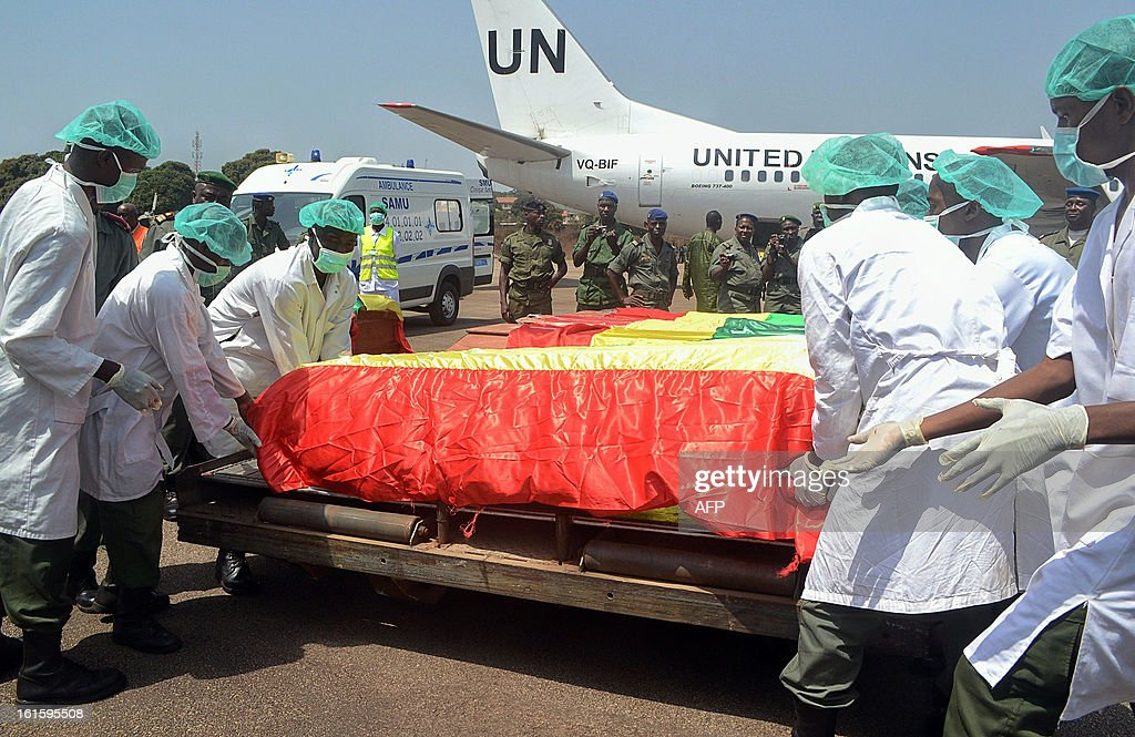 The coffins of the victims of the February 11, 2013 plane crash in the Liberian town of Charlesville arrive on February 12 at an air base outside Conakry. A plane carrying a military delegation from Guinea crashed on February 11 in Charlesville, killing the army chief of staff, General Souleymane Kelefa Diallo, and 10 other people. The plane was carrying the delegation to attend an armed forces day in Liberia, which holds ceremonies each year to recognize its military and often invites officers from neighbouring countries, including Guinea. AFP PHOTO / MAMADOU CELLOU DIALLO