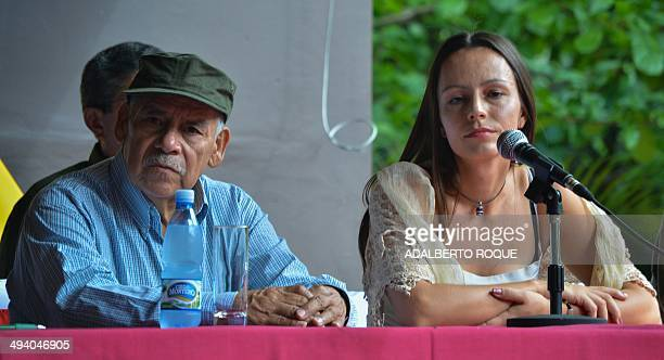 The cofounder of the Revolutionary Armed Forces of Colombia commander Miguel Pascuas and guerrilla fighter Tanja Nijmeijer attend a press conference...